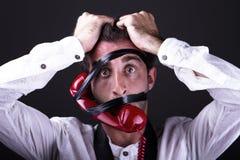 Un telephoneman desesperado Imagen de archivo libre de regalías