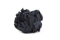 Un terrón del papel arrugado negro fotografía de archivo libre de regalías