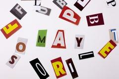 Un texto de la escritura de la palabra que mostraba el concepto de MAYO hizo de diversa letra del periódico de la revista para el Fotografía de archivo