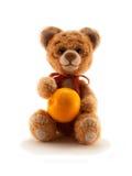 Un tigre tricoté par jouet avec une orange Images stock