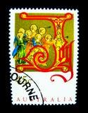 Un timbre imprimé dans l'Australie montre une image d'un groupe d'anges jouant une trompette sur la valeur au cent 45 images libres de droits