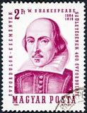 Un timbre imprimé en Hongrie montre une image de portrait de William Shakespeare image libre de droits
