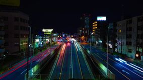 Un timelapse de la rue au centre ville ? Tokyo ? la longue exposition de nuit a au loin tir? l'inclinaison clips vidéos