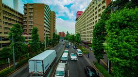 Un timelapse de rue du centre à l'avenue de Kanpachi dans l'inclinaison tirée large de jour de Tokyo banque de vidéos