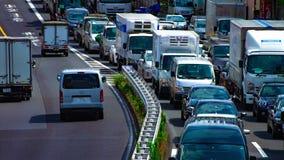 Un timelapse de rue de voiture à l'avenue de Kanpachi dans l'inclinaison de jour de Tokyo banque de vidéos
