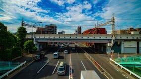 Un timelapse de rue de voiture à l'avenue de Kanpachi dans l'inclinaison tirée large de jour de Tokyo banque de vidéos