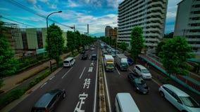 Un timelapse de rue de voiture à l'avenue de Kanpachi dans l'inclinaison tirée large de jour de Tokyo clips vidéos