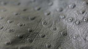 Un tiro macro de la textura perforada gris oscuro del fondo del cuero artificial metrajes