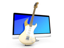 Un tout dans un ordinateur avec une guitare Image libre de droits