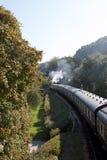 Un train de vapeur sur un voyage Photo stock