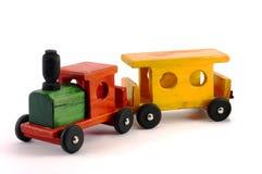 Un train en bois lumineux de jouet d'isolement Photo libre de droits
