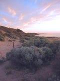 Un tramonto vago della spiaggia di estate Immagine Stock
