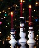 Un trio des bougies de bonhomme de neige Photos libres de droits