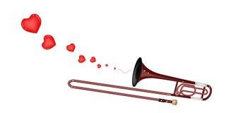 Un trombone symphonique soufflant un beau coeur Photo stock