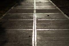 Un trottoir au coucher du soleil Image libre de droits