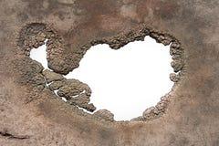Un trou avec les bords de décomposition déchiquetés Image libre de droits