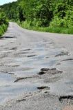 Un trou dans la route. Photographie stock libre de droits