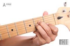 Un tutorial de menor importancia del acorde de la guitarra Imágenes de archivo libres de regalías