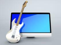 Un tutto in un computer con una chitarra Fotografia Stock Libera da Diritti