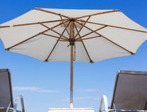 Un umbrella and sunbeds on your private beach Royalty Free Stock Photo