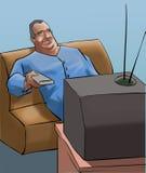 Un uomo anziano che guarda TV Fotografie Stock Libere da Diritti