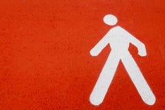 Un uomo bianco a terra del segnale stradale Immagini Stock Libere da Diritti