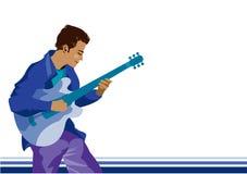 Un uomo che gioca chitarra Fotografia Stock Libera da Diritti
