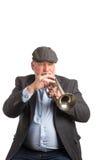 Un uomo che gioca una cornetta Fotografie Stock