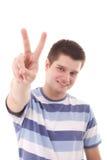 Un uomo che indica una vittoria Fotografia Stock