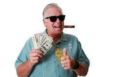 Un uomo con soldi Un uomo vince i soldi Un uomo ha soldi Un uomo fiuta i soldi Un uomo ama i soldi Un uomo ed i suoi soldi Un uom fotografia stock libera da diritti
