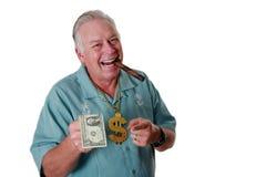 Un uomo con soldi Un uomo vince i soldi Un uomo ha soldi Un uomo fiuta i soldi Un uomo ama i soldi Un uomo ed i suoi soldi Un uom fotografie stock libere da diritti