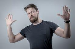 Un uomo con una barba Immagini Stock
