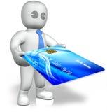 Un uomo con una grande carta di credito Immagini Stock Libere da Diritti