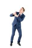 Un uomo d'affari ansioso che tira qualcosa Fotografie Stock Libere da Diritti