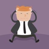 Un uomo d'affari che graffia il suo capo. Immagini Stock