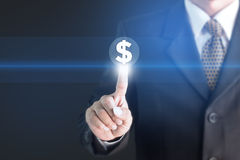 Un uomo d'affari che tiene un segno bianco con la valuta degli Stati Uniti del messaggio Fotografia Stock Libera da Diritti