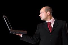 Un uomo d'affari con il computer portatile Fotografia Stock