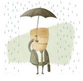 Uomo d'affari felice sotto un ombrello Immagini Stock