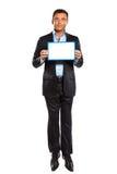 Un uomo di affari che salta mostrando whiteboard Immagini Stock Libere da Diritti