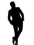 Un uomo di affari che si leva in piedi la casella integrale delle mani Fotografia Stock Libera da Diritti