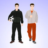 Un uomo di due sport con un pallone da calcio Immagine Stock Libera da Diritti