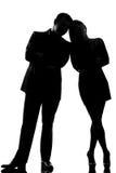 Un'uomo e donna delle coppie che si levano in piedi faccia a faccia Fotografia Stock