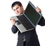 Un uomo sta tenendo un computer portatile Fotografia Stock
