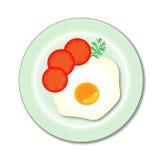 Un uovo fritto su un piatto Fotografia Stock