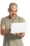 Un utilizador feliz del netbook fotografía de archivo libre de regalías