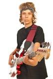 Un varón más joven que toca la guitarra baja Imagen de archivo libre de regalías