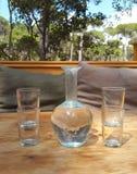 Un vaso bevente di vetro Fotografia Stock