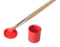 Un vaso di gouache con la spazzola vicino esso Fotografie Stock