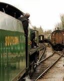 Un treno del vapore che si avvicina ad un raccordo ferroviario Fotografie Stock Libere da Diritti