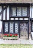 Un vecchio di legno con la casa nera della porta veduta in segale, Risonanza, Regno Unito Immagini Stock Libere da Diritti